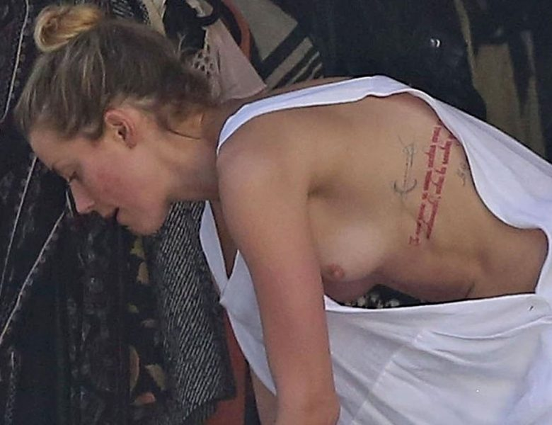 Tatted-Up Blonde Amber Heard Accidentally Flashing Her Nipple