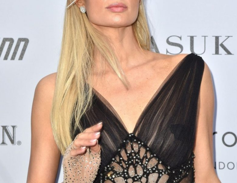 Sophisticated Paris Hilton Striking Poses in a Semi-Transparent Black Dress
