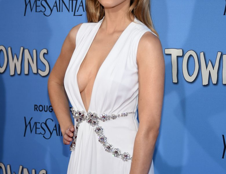 Brazen Beauty Halston Sage Striking Poses in a Cleavage-Baring Dress