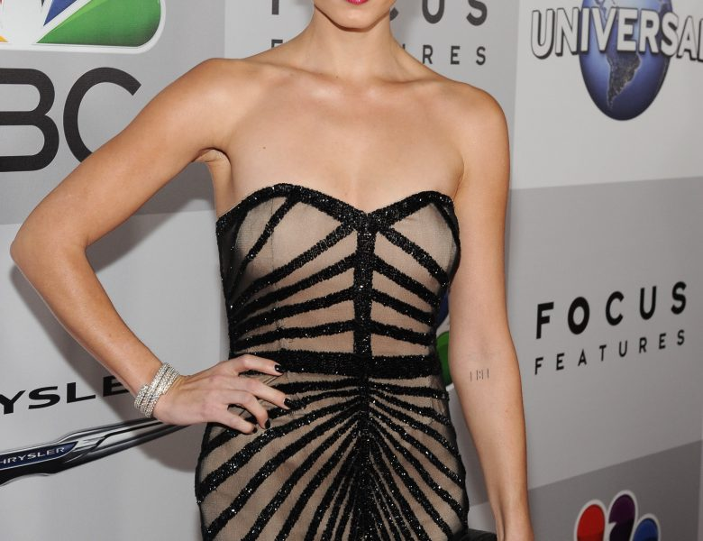 Blond-Haired Beauty Laura Vandervoort Looks Hot in a Cleavage-Baring Dress