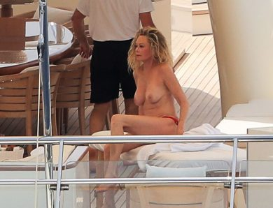 Topless MILF Melanie Griffith Gets Her Perfect Body Massaged on a Yacht