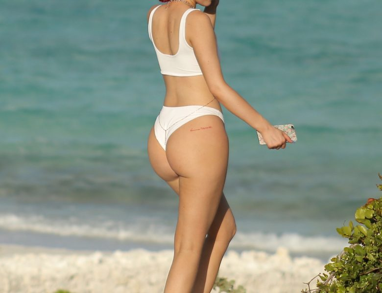 Red-Haired Beauty Kylie Jenner Shows Her Impressive Ass in a White Bikini